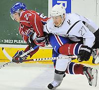 Hamilton Bulldogs' Joonas Nattinen, left, is taken down by San Antonio Rampage's Greg Rallo during the first period of an AHL hockey game, Wednesday, March 28, 2012, in San Antonio. (Darren Abate/pressphotointl.com)