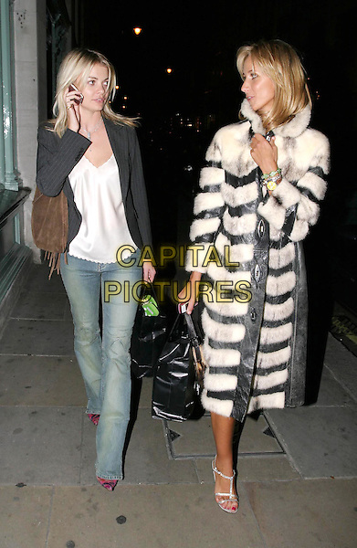 JEMMA KIDD & LADY VICTORIA HERVEY.Tatler Little Black Book party at Tramp nightclub.full length, full-length, denim jeans, pinstripe blazer, brown suede bag, mobile phone, long black & white stripy stripes fur coat, silver strappy sandals.www.capitalpictures.com.sales@capitalpictures.com.© Capital Pictures.