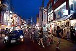People walk through the main shopping area of  Shimokitazawa, Setagaya Ward, Tokyo, Japan..Photographer: Robert Gilhooly