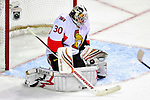 22 March 2010: Ottawa Senators' goaltender Brian Elliott makes a first period save against the Montreal Canadiens at the Bell Centre in Montreal, Quebec, Canada. The Senators shut out the Canadiens 2-0 in their last meeting of the regular season. Mandatory Credit: Ed Wolfstein Photo