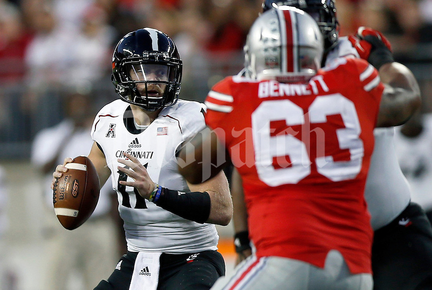 Cincinnati Bearcats quarterback Gunner Kiel (11) looks for a receiver during the second quarter of Saturday's NCAA Division I football game at Ohio Stadium in Columbus on September 27, 2014. (Columbus Dispatch photo by Jonathan Quilter)