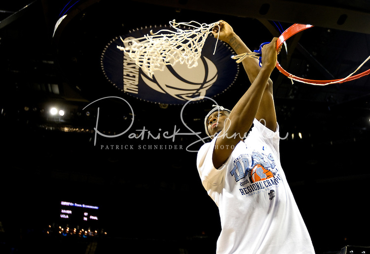 North Carolinas Ty Lawson cuts down the net during the NCAA Basketball Men's East Regional at Time Warner Cable Arena in Charlotte, NC.