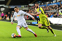 (L-R) Connor Roberts of Swansea City chased by Richard Duffy of Notts County during The Emirates FA Cup match between Swansea City and Notts County at The Liberty Stadium, Swansea, Wales, UK. Tuesday 06 February 2018