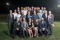 Group photo with some of the Occidental College football team that played with Andy Collins '07, including coach Dale Widolff and Betty and Mike Collins P'07, parents of Andy Collins '07 and Brooke Olzendam, widow of Andy Collins '07.<br /> The Occidental community celebrates its student-athletes with the induction of the sixth class into the Occidental College Athletics Hall of Fame during Homecoming and Family Weekend on Friday, Oct. 13, 2017 in Jack Kemp Stadium. The 2017 inductees are Stephen Haas '63 (track and field), the 1982 women's tennis team (NCAA national champions), Blair Slattery '94 (basketball and tennis), and the late Andy Collins '07 (football, track and field).<br /> (Photo by Marc Campos, Occidental College Photographer)