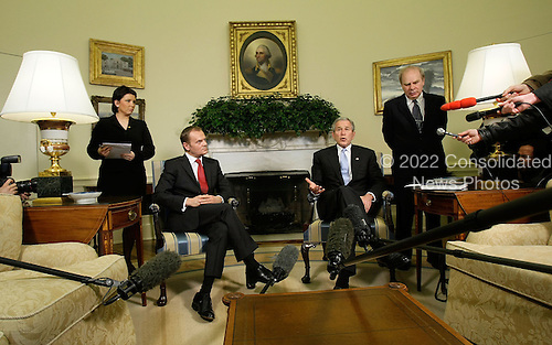 Washington, DC - March 10, 2008 -- United States President George W. Bush (2nd-R) speaks to the media as Polish Prime Minister Donald Tusk (2nd-L) looks on during a meeting at the Oval Office of the White House March 10, 2008 in Washington, DC. Tusk is in Washington to discuss the inclusion of Poland in a U.S. missile defense system with President Bush.  (Photo by Alex Wong/Getty Images) .Credit: Alex Wong / Pool via CNP