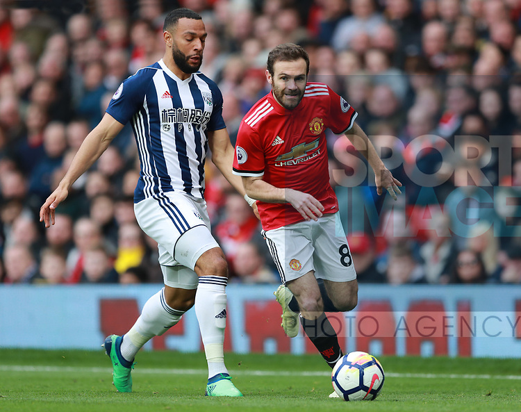 Juan Mata of Manchester United skips past Allan Nyom of West Bromwich Albion during the premier league match at the Old Trafford Stadium, Manchester. Picture date 15th April 2018. Picture credit should read: Simon Bellis/Sportimage
