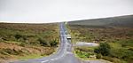 Road crossing moorland near Postbridge, Dartmoor national park, Devon, England, UK
