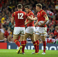 Pictured: Lloyd Williams of Wales (C) celebrates his try which was later disallowed, with team mates Scott Williams (L) and Rhys Priestland (R) Sunday 20 September 2015<br />