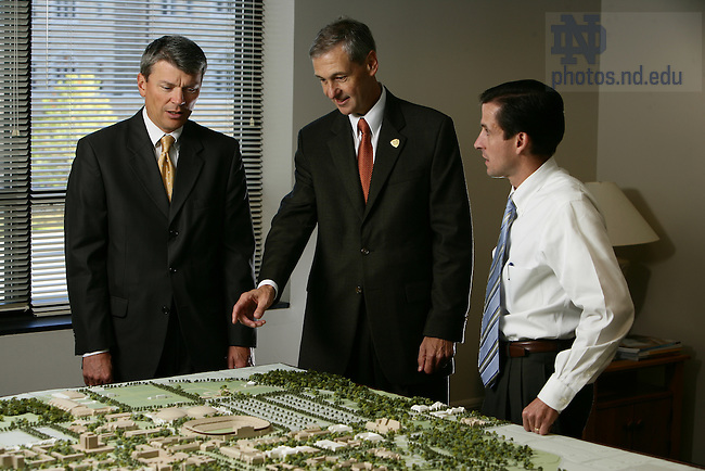 John Affleck-Graves looks over the campus model with University Architect Doug Marsh