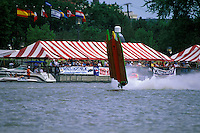 Frame 5: Halfway around the first lap, Wyatt Nelson (#39) blows the boat over crashing back to the water. Nelson was unhurt in the crash. (SST-120 class) Bay City, MI 1998