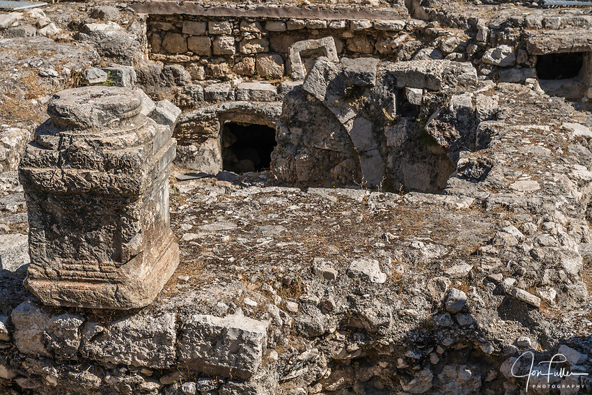 A Byzantine pillar among ruins of the Roman baths next to the Church of Saint Anne and the Bethesda Pools in the Muslim Quarter of the Old City of Jerusalem.  The Old City of Jerusalem and its Walls is a UNESCO World Heritage Site.  These were the healing baths of Bethesda at the time of Christ.