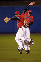 Ball State Cardinals outfielders CJ Alexander (20), Alex Call (back), and Matt Eppers (35) celebrate after a game against the Wisconsin-Milwaukee Panthers on February 26, 2016 at Chain of Lakes Stadium in Winter Haven, Florida.  Ball State defeated Wisconsin-Milwaukee 11-5.  (Mike Janes/Four Seam Images)