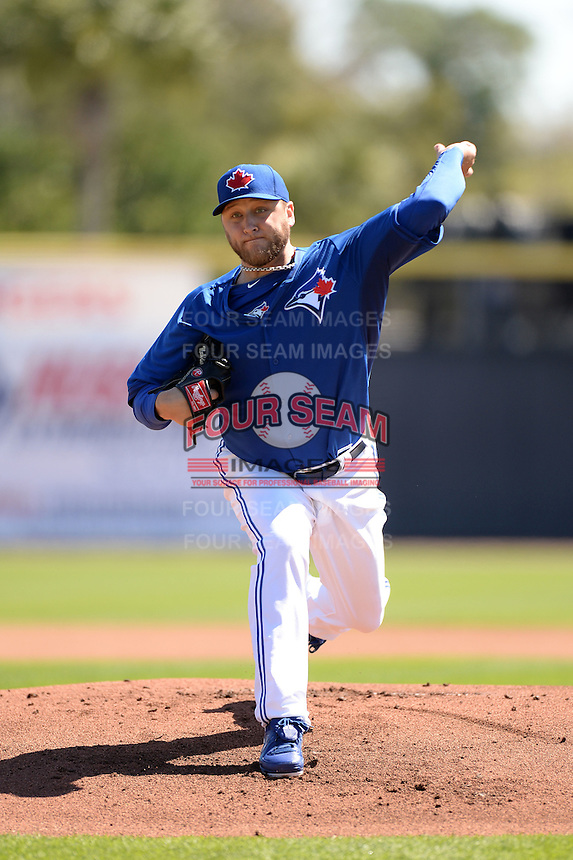 Toronto Blue Jays pitcher Mark Buehrle (56) during a spring training game against the Pittsburgh Pirates on February 28, 2014 at Florida Auto Exchange Stadium in Dunedin, Florida.  Toronto defeated Pittsburgh 4-2.  (Mike Janes/Four Seam Images)