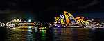 A cruise ship passes the Sydney Opera House during the 2016 Vivid Light Festival.