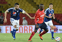 BOGOTA - COLOMBIA, 04-08-2018: Andres Cadavid Cardona (Izq) jugador de Millonarios disputa el balón con Juan F Caicedo (Der) jugador de Deportivo Independiente Medellín durante partido por la fecha 3 de la Liga Águila II 2018 jugado en el estadio Nemesio Camacho El Campin de la ciudad de Bogotá. / Andres Cadavid Cardona (L) player of Millonarios fights for the ball with Juan F Caicedo (R) player of Deportivo Independiente Medellin during the match for the date 3 of the Liga Aguila II 2018 played at the Nemesio Camacho El Campin Stadium in Bogota city. Photo: VizzorImage / Gabriel Aponte / Staff.