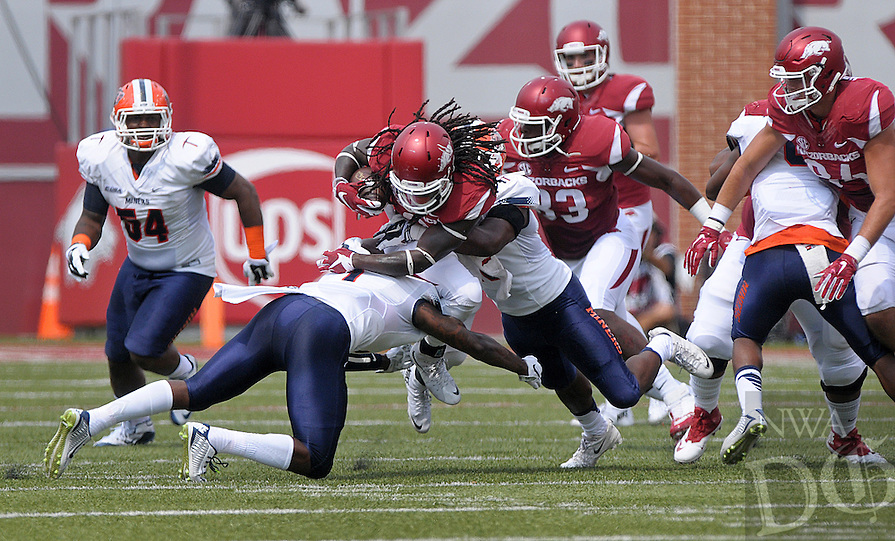 NWA Democrat-Gazette/BEN GOFF @NWABENGOFF<br /> Trent Trammell (1) and fellow UTEP defender Alvin Jones tackle Alex Collins, Arkansas running back, on Saturday Sept. 5, 2015 during the first quarter of the game in Razorback Stadium in Fayetteville.
