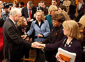 Washington, D.C. - March 24, 2004 -- Family members crowd around Richard A. Clarke at the conclusion of his testimony before the National Commission on Terrorist Attacks Upon the United States hearing  in Washington, DC on March 24, 2004. From left to right: Richard Clarke, Carol Ashley, Beverly Eckert, Rosemary Dillard, and unidentified.<br /> Credit: Ron Sachs / CNP<br /> [RESTRICTION: No New York Metro or other Newspapers within a 75 mile radius of New York City]