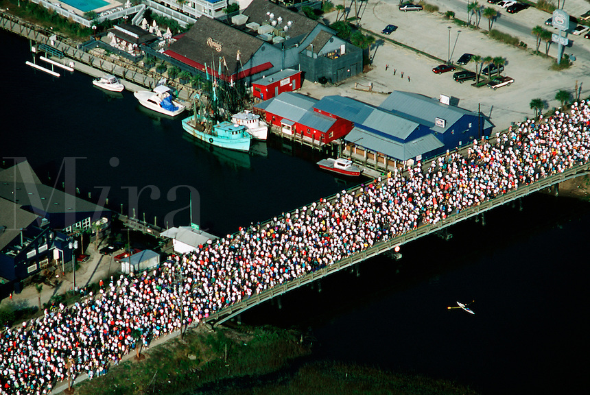 Runners on bridge at the start of a race. Cooper River, South Carolina.