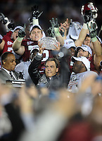 Jan 7, 2010; Pasadena, CA, USA; Alabama Crimson Tide head coach Nick Saban holds up the Coaches' Trophy and celebrates after defeating the Texas Longhorns 37-21 in the 2010 BCS national championship game at the Rose Bowl. Mandatory Credit: Mark J. Rebilas-..