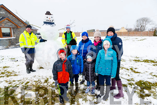 Kieran Fennell, Micheal Foley, Cian Fennell, Shay Fennell, Jamie Keane, Satires Fennell, Grace Wheelan, Aideen Wheelan, Claire Fennell building a giant snowman in Lisselton on Friday.