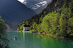 Rowing boat on lake Plansee near Reutte, Austrian Alps. Austria.
