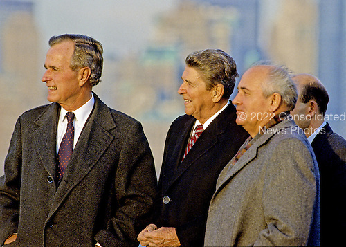 United States President-elect George H.W. Bush, left, and U.S. President Ronald Reagan, center, and USSR General Secretary Mikhail Gorbachev, right, view the New York City skyline after meeting on Governor's Island, New York on December 7, 1988..Credit: Arnie Sachs / CNP.