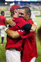 Stony Brook Seawolves outfielder Travis Jankowski #6 is hugged by his teammates after the NCAA Super Regional baseball game against LSU on June 10, 2012 at Alex Box Stadium in Baton Rouge, Louisiana. Stony Brook defeated LSU 7-2 to advance to the College World Series. (Andrew Woolley/Four Seam Images)