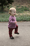 Berkeley, CA Girl, one year old, showing off new walking skill at public park MR