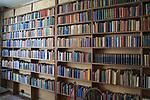 Bookshelves inside the library at Sissinghurst castle gardens, Kent, England, UK