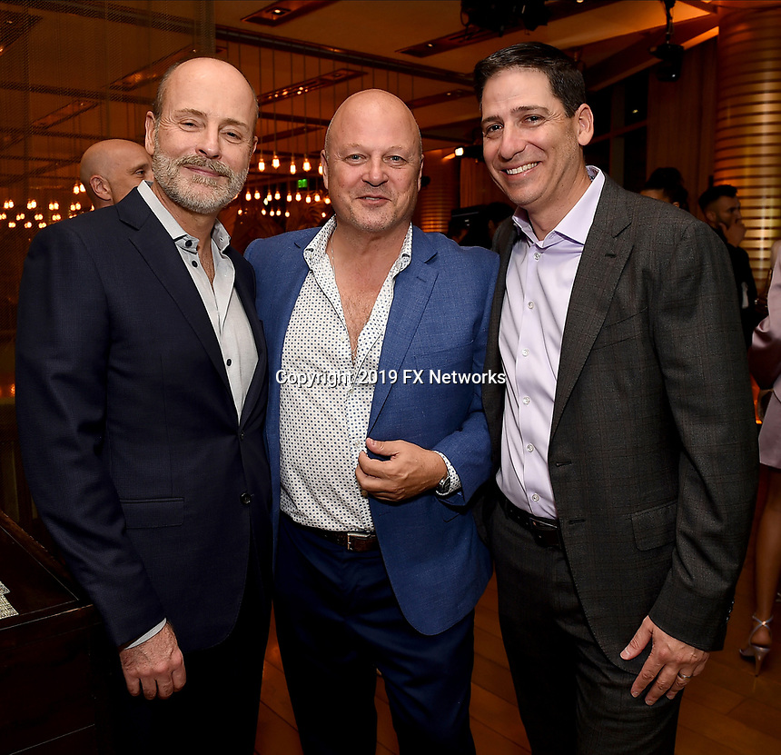 LOS ANGELES - SEPTEMBER 21: (L-R) John Landgraf, Michael Chiklis, and Eric Schrier, President, FX Entertainment attend the FX Networks & Vanity Fair Pre-Emmy Party at Craft LA on September 21, 2019 in Los Angeles, California. (Photo by Frank Micelotta/FX/PictureGroup)