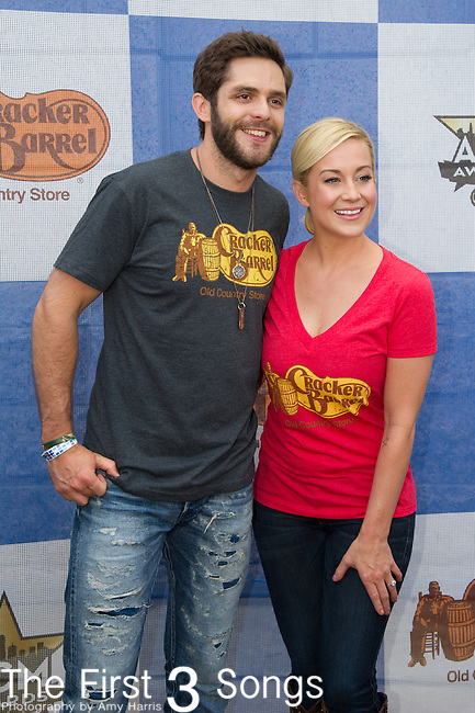 Thomas Rhett and Kellie Pickler attend the Cracker Barrel Old Country Store Country Checkers Challenge at Globe Life Park in Arlington on April 18, 2015 in Arlington, Texas