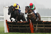 Double Handful ridden by Barry Geraghty (L) and Luggers Hall ridden by Lee Edwards jump the last in the Emma Lavelle Racing Novices Handicap Hurdle - Horse Racing at Newbury Racecourse, Berkshire