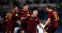 Calcio, Serie A: Roma vs Milan. Roma, stadio Olimpico, 12 dicembre 2016.<br /> Roma&rsquo;s Radja Nainggolan, second from right, celebrates  with teammates Daniele De Rossi, left, Kevin Strootman, second from left, and Edin Dzeko, after scoring during the Italian Serie A football match between Roma and AC Milan at Rome's Olympic stadium, 12 December 2016.<br /> UPDATE IMAGES PRESS/Isabella Bonotto