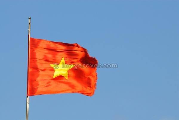 Asia, Vietnam, Nha Trang. Po Nagar Cham Towers. Vietnamese flag.