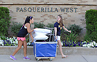 August 17, 2012; Orientation staff member Lauren Haruno (left) helps Caitlyn Beauchamp of Gainsville, Florida, with her belongings as she moves into Pasquerilla West Hall.  Photo by Barbara Johnston/University of Notre Dame