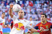Joel Lindpere (20) of the New York Red Bulls and Tony Beltran (2) of Real Salt Lake during a Major League Soccer (MLS) match at Red Bull Arena in Harrison, NJ, on October 09, 2010.