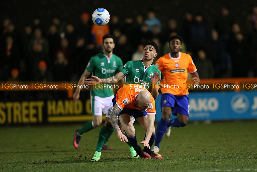 Josh Ginnelly of Lincoln City tangles with Sean Clohessy of Braintree Town during Braintree Town vs Lincoln City, Vanarama National League Football at the IronmongeryDirect Stadium on 7th March 2017