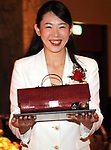 "October 12, 2017, Tokyo, Japan - A hotel clerk displays a handbag shaped Christmas cake ""Pour ma Chere"" priced 28,000 yen at a press preview for the Prince Hotels chain's Christmas cake collection at the Prince Park Tower hotel  in Tokyo on Thursday, Octoebr 12, 2017. The hotel chain started to accept orders and will deliver before Christmas Day.   (Photo by Yoshio Tsunoda/AFLO) LWX -ytd-"