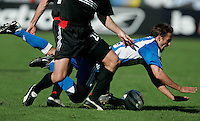 Kansas City Wizards' Josh Wolf is pushed to the ground by D.C. United's defenders during a 3-2 loss at the MLS Cup, at the Home Depot Center, in Carson, Calif., Sunday, Oct. 14, 2004.
