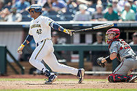 Michigan Wolverines designated hitter Jordan Nwogu (42) follows through on his swing during Game 11 of the NCAA College World Series against the Texas Tech Red Raiders on June 21, 2019 at TD Ameritrade Park in Omaha, Nebraska. Michigan defeated Texas Tech 15-3 and is headed to the CWS Finals. (Andrew Woolley/Four Seam Images)