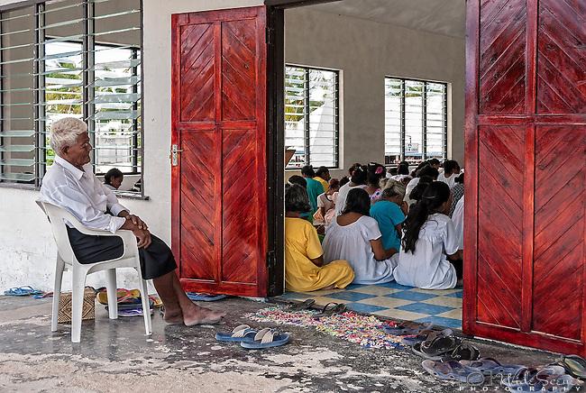 An elder observes Sunday church service on the remote island of Kiritimati in Kiribati