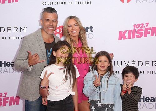 CARSON, CA - June 1: Edwin Arroyave, Teddi Mellencamp, Cruz Arroyave, Slate Arroyave, at 2019 iHeartRadio Wango Tango Presented By The JUVÉDERM® Collection Of Dermal Fillers at Dignity Health Sports Park in Carson, California on June 1, 2019.   <br /> CAP/MPI/SAD<br /> ©SAD/MPI/Capital Pictures