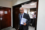 Palestinian Chief Negotiator Saeb Erekat, leaves a meeting with his staff at the Negotiations Affairs Department in Ramallah, West Bank.<br />