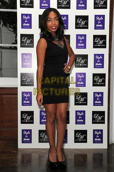 Zaraah Abrahams.Style for Stroke Launch Party held at No.5 Cavendish Square, London, England..October 2nd 2012.half length black sleeveless dress hand on hip  .CAP/CAS.©Bob Cass/Capital Pictures.