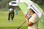 Lisa Meldrum (right) from Montreal, Quebec awaits for Moon Su (left) Incheon, South Korea on the 6th hole during Alliance Bank Golf Classic in Syrcause, NY.
