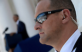 A Secret Service agent stands guard as United States President Barack speaks during a Memorial Day event at Arlington National Cemetery, May 25, 2015 in Arlington, Virginia. <br /> Credit: Olivier Douliery / Pool via CNP