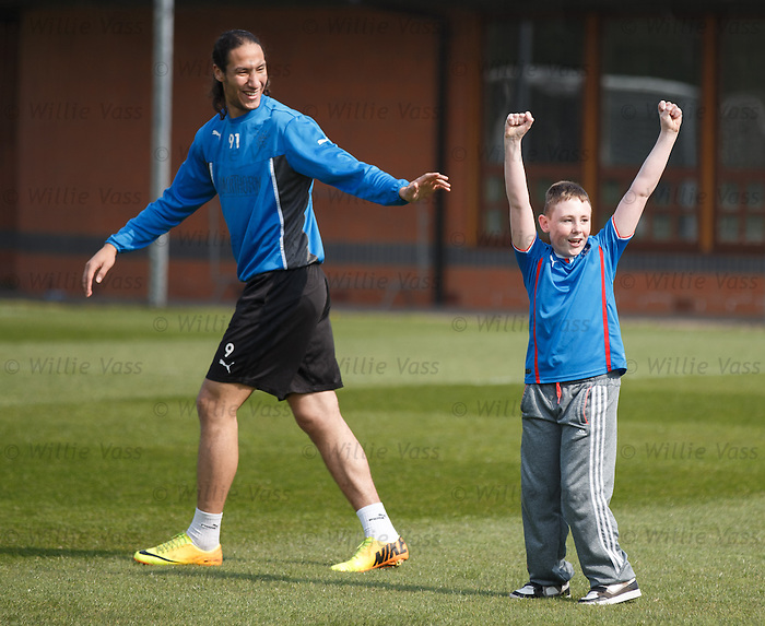 Bilel Mohsni takes a young disabled kid onto the park for some football fun as fans group Sons of Struth arrange for a visit of the training centre with the players