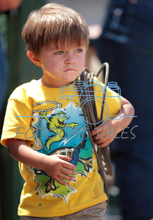 Dante Sceirine, 3, waits for his dad at the Minden Ranch Rodeo, in Gardnerville, Nev., on Saturday, July 21, 2012..Photo by Cathleen Allison