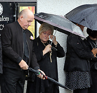 "COPY BY TOM BEDFORD<br /> Pictured: Mourners attending the service at the Jerusalem Baptist Chapel, Merthyr Tydfil, Wales, UK. Friday 18 August 2017<br /> Re: The funeral of a toddler who died after a parked Range Rover's brakes failed and it hit a garden wall which fell on top of her will be held today at Jerusalem Baptist Chapel in Merthyr Tydfil.<br /> One year old Pearl Melody Black and her eight-month-old brother were taken to hospital after the incident in south Wales.<br /> Pearl's family, father Paul who is The Voice contestant and mum Gemma have said she was ""as bright as the stars""."