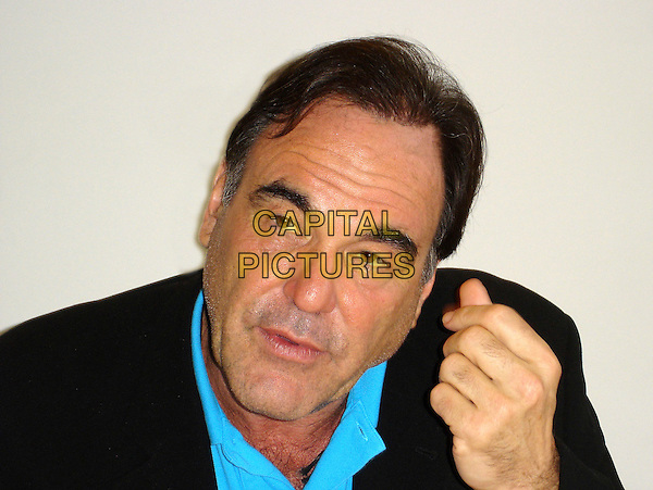 "OLIVER STONE.""World Trade Center"" Press Conference,.Four Seasons Hotel,  Beverly Hills, California , USA,.July 13th 2006..portrait headshot centre hand gesture               .Ref: AW.www.capitalpictures.com.sales@capitalpictures.com.©Anita Weber/Capital Pictures."